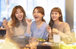 Happy young Group eating in the restaurant stock images