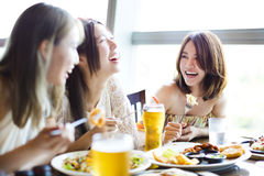 Happy young group enjoying dinner party. Happy young women group enjoying dinner party Royalty Free Stock Photos