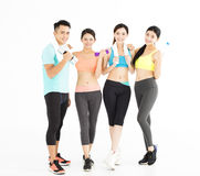 Happy young group of fit people standing in gym Stock Photography