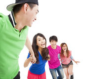Happy  young group running for fun Stock Photos