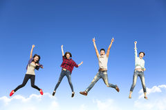 Happy young group jumping together Royalty Free Stock Photos