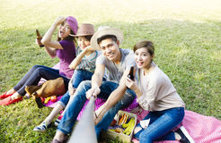 Happy young group making selfie by  smart phone Royalty Free Stock Photos