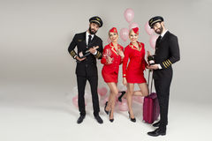 Happy young group of pilots and stewardesses Royalty Free Stock Photos