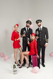 Happy young group of pilots and stewardesses Royalty Free Stock Images