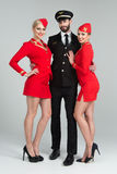 Happy young group of pilots and stewardesses Stock Images