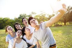 Happy young group taking selfie in the park Stock Photography