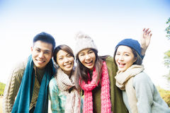 Happy young group with winter wear Stock Images