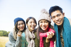 Happy young group with winter wear Royalty Free Stock Image