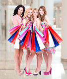 Happy young group of women  after shopping in the big mall Stock Images