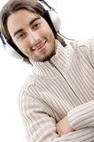 Happy young guy busy with music Stock Photos