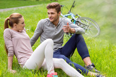 Happy young guy and girl dating in nature Royalty Free Stock Images