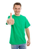 Happy young guy in green t-shirt with thumbs up - isolated on wh Stock Photo
