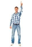 Happy young guy pointing upwards. Full shot stock photos