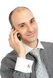 Happy young guy speaking on cell phone Royalty Free Stock Image