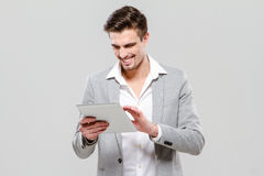 Happy young guy using tablet Stock Photo