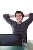 Happy young guy works on his laptop Stock Photos