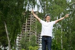 Happy Young handsome man on the background of summer street Royalty Free Stock Photo