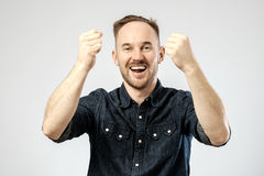 Happy young handsome man gesturing Royalty Free Stock Photos