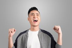 Happy young handsome man gesturing and keeping mouth open lookin Royalty Free Stock Photo