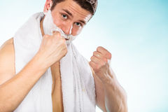 Happy young handsome man with shaving cream foam. Stock Image