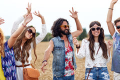Happy young hippie friends dancing on cereal field Royalty Free Stock Image