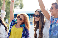 Happy young hippie friends dancing outdoors Stock Images