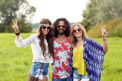 Happy young hippie friends showing peace outdoors Stock Photography