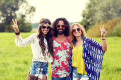 Happy young hippie friends showing peace outdoors Stock Photos