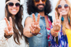 Happy young hippie friends showing peace outdoors Royalty Free Stock Image