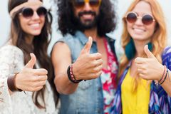 Happy young hippie friends showing thumbs up. Youth culture, gesture and people concept - smiling young hippie friends in sunglasses showing thumbs up hand sign Royalty Free Stock Photos