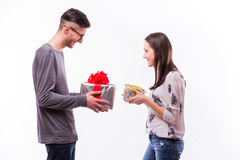 Free Happy Young  Hipster Couple Change With Present Each Other  Isolated On A White Background. Royalty Free Stock Photo - 67697105