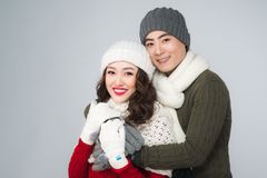 Happy young hipster couple hugging. Cold season. Romantic mood. Stock Photos