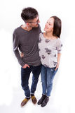 Happy young  hipster couple hugs at camera. Focus from sky Royalty Free Stock Photo