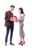 Happy young hipster couple with present isolated on a white background. royalty free stock photography