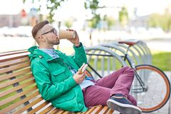 Happy young hipster man with coffee and sandwich Royalty Free Stock Images
