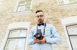 Happy young hipster man with film camera in city Royalty Free Stock Photos