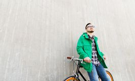 Happy young hipster man with fixed gear bike Royalty Free Stock Photography