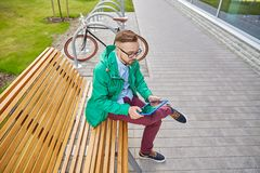 Happy young hipster man with tablet pc and bike Royalty Free Stock Image