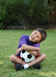 Happy young hispanic boy with soccer ball royalty free stock image