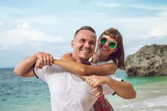 Happy young honeymoon couple having fun on the beach. Ocean, tropical vacation on Bali island, Indonesia. Happy young honeymoon couple having fun on the beach Royalty Free Stock Photo