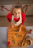 Happy young housewife chopping walnuts Royalty Free Stock Image