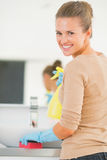 Happy young housewife cleaning in bathroom Stock Images