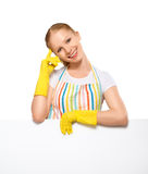 Happy young housewife in glove with white empty billboard isolat Royalty Free Stock Photo