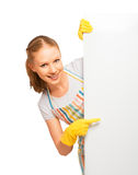 Happy young housewife in glove with white empty billboard isolated. On white background royalty free stock photo