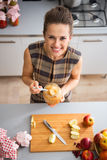Happy young housewife holding jar with apple jam Stock Photography