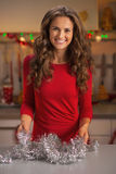 Happy young housewife making christmas preparations Stock Image