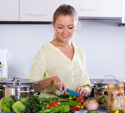 Happy young housewife preparing food Royalty Free Stock Photo