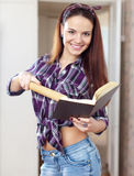 Happy young housewife reads book Stock Photo