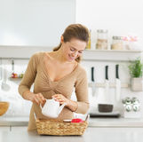 Happy young housewife serving breakfast tray Stock Photography