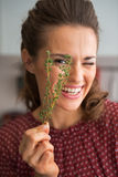 Happy young housewife showing fresh thymus Stock Photography